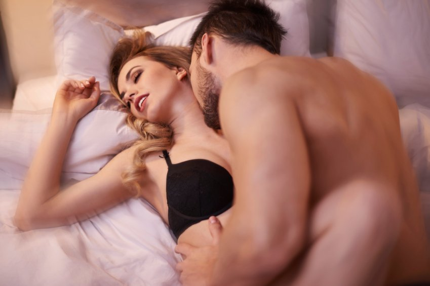 a man sufficiently pleasuring his woman in the bedroom