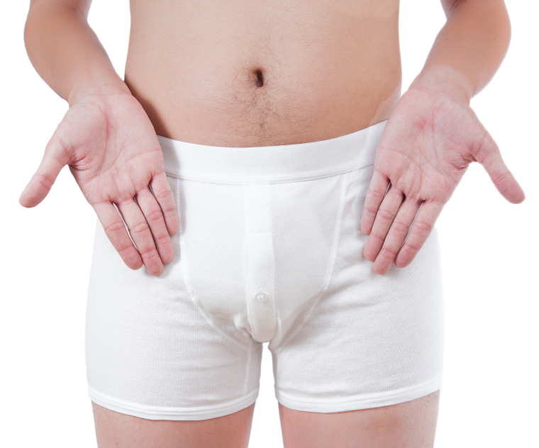 a man in his underwear pointing at his penis