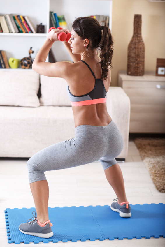 fitness chick doing squats at home