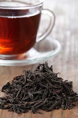 black tea leaves and liquid brew