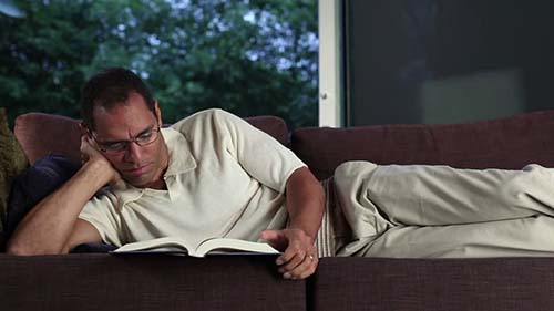 man relaxing at home after a hard day at work