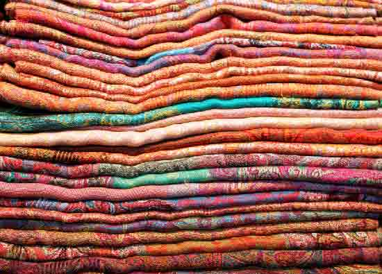 a stack of bed quilts