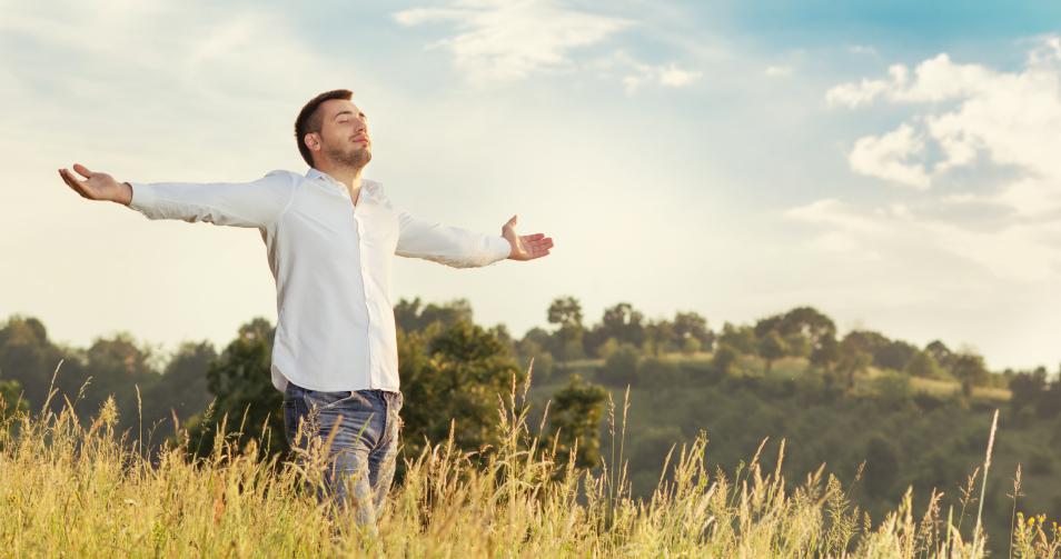 a free man in a grass field