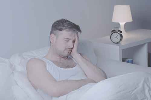 a man with insomnia from wearing a penis extender while sleeping.
