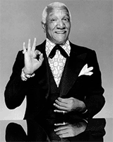Redd Foxx doing an ok-grip