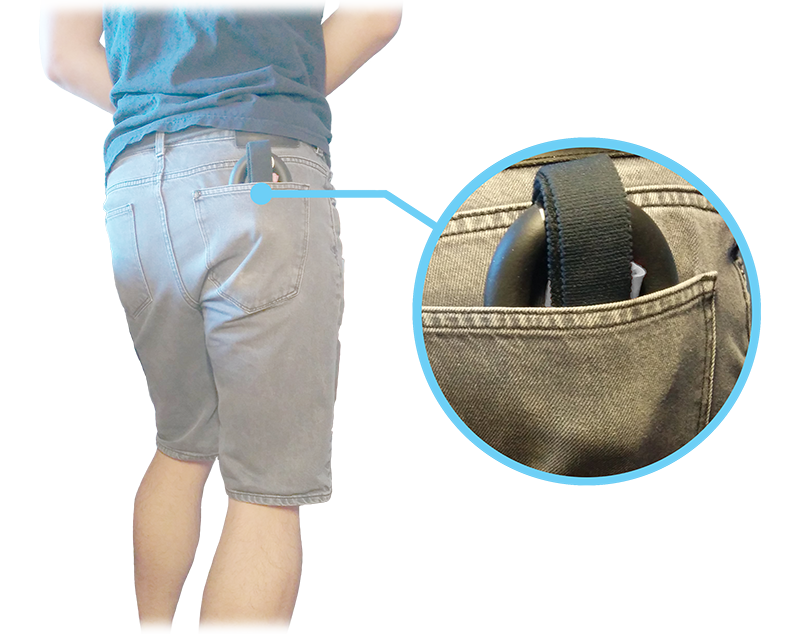 The Model S Penis Extender device being stored in the back pocket of the user's pants